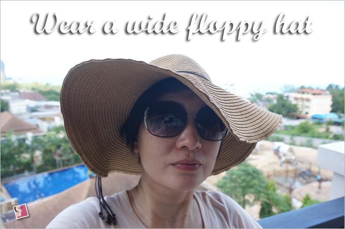 wear a wide brim floppy hat