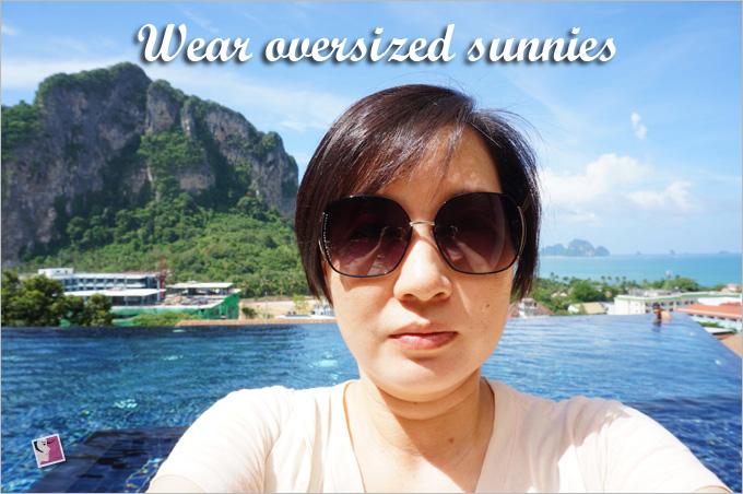 wear oversized sunglasses